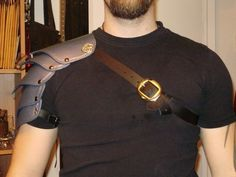 Leather celtic shoulder armor with metal looking finish, SCA, LARP. $140.00, via Etsy.