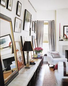 Art hangs from a rod attached to the ceiling; via #Canadian #House and Home. ruemarcellin.com