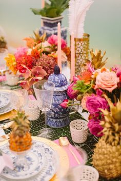 Lots of colors and flowers and happiness on the wedding tables