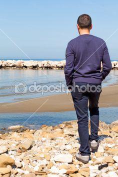 Man On The Beach Watching Over Horizon