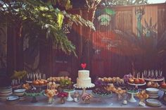 I like the overall look of the dessert table. And everybody LOVES that cake topper! I was thinking of possible alternative to a heart... The colors/coloring are too dark for me personally. Not sure if it's the selection or the photography.