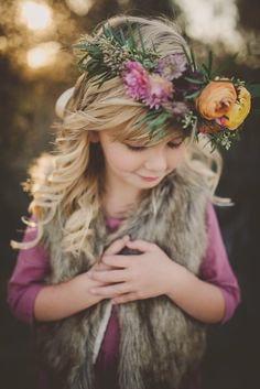 love the floral crown and fur vest
