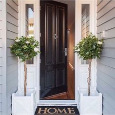 This combination of paint colour is so perfectly stylish- built by @evermoredesignedhomes #frontdoor#frontdoorstyling#exteriors#hoke#paintcolour#classichomes