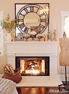 I love this fireplace mantel and that fun mirror clock - beautiful home tour of Tidbits & Twine eclecticlalyvintage.com