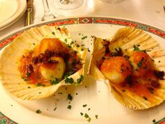 Scallops at Botafumerio Of course Albarino wine goes with Shellfish!! As soon as you enter the door you know you have found a seafood lovers paradise. They have a large bar where you can eat or ask to be seated in the back in their quiet alcoves. The food is excellent and the service was as well. Be sure to try the Sea Bass or the shell fish platter. Make Botafumeiro a stop for dinner while in Barcelona.