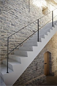 raw brick. painted stairs. simple ballastrade.