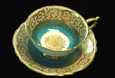 Paragon English Bone China...Teacup & Saucer...(I <3 the gold medallion in the center of the cup)