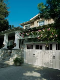 Amarr Classica® Tuscany garage door in True White with Madeira Windows and optional Blue Ridge Handles. Visit www.amarr.com for more great styles.