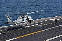 "170311-N-MG079-203  SUEZ CANAL (March 11, 2016) An MH-60R Sea Hawk helicopter assigned to the ""Spartans"" of Helicopter Maritime Strike Squadron (HSM) 70 lands aboard the aircraft carrier USS George H.W. Bush (CVN 77).  The ship and its carrier strike group are deployed in support of maritime security operations and theater security cooperation efforts. (U.S. Navy photo by Mass Communication Specialist 2nd Class Patrick Ian Crimmins/Released)"