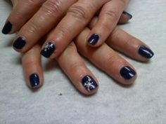 navy with snowflake accent nails   Oasis salon and Spa Mill Hall Pa (570)726-6565
