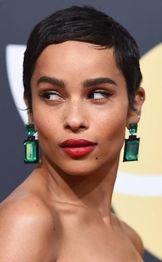 Zoe Kravitz from Best Accessories at Golden Globes 2018  The Big Little Lies actress' emerald-green drop earring took us back to the 2009 Oscars, when Angelina Jolie wore a similar stunning pair. However, Zoe modernized the look with more streamlined rectangular shapes.