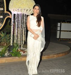 Karisma Kapoor was a vision in a white Manish Malhotra net sari paired with a matching clutch. (Source: Varinder Chawla)