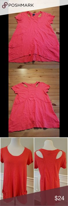 """Anthropologie Coral Cut Out Back Tunic Tee SZ S Left of Center for Anthropologie coral cotton knit swing tee with cut outs on back shoulders and an asymmetrical flared hemline with two bottom pockets on front. Size small. Excellent condition. 100% cotton. 26"""" to hem in back, 23"""" to hem in front, 17.5"""" across bust. Anthropologie  Tops Tunics"""