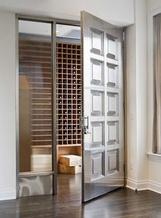 A door that once graced Tiffany's serves as the entrance to the NY apartment wine room