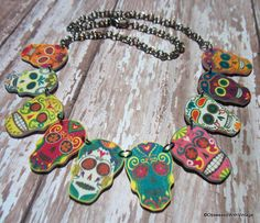 day of dead  necklace mulitple sugar skull rainbow flower charm  FREE US SHIPPING. $29.95, via Etsy.