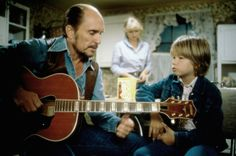 Robert Duvall (Mac Sledge) in Tender Mercies with Tess Harper in the background.http://media.timeout.com/images/resizeBestFit/100697125/660/370/image.jpg