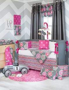 Glenna Jean Addison 3 - 4 Pc Crib Bedding Set Includes quilt, white sheet, crib skirt. Popping Colors of lively gray, white and pink color combination in coordinating floral, pink dots and zigzag patterns. #waughinteriordesigns #Crib_Bedding #Nursery_Room
