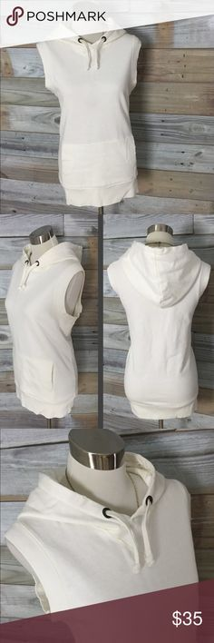 {Free People} Sleeveless Kangaroo Hoodie This is such a cool little loungie piece...sleeveless white sweatshirt--super warm and super soft--with drawstring hoodie and a nice long tunic-style hemline with kangaroo pocket in front. This is perfect with a thermal, leggings and tennies for those winter yoga classes...or just days where you're going for that sporty-chic look and need to raise the exercise style bar :-) Free People; Size Large Free People Tops Sweatshirts & Hoodies