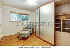 View of the room corner with chair and open slide doors wardrobe cabinet with… Room Corner, Corner Chair, Wardrobe Cabinets, Bedroom Windows, Master Bedroom, Drawers, Shelves, Stock Photos, Furniture