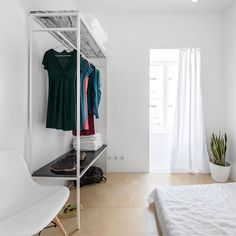 Set in Lisbon, Portugal, the Graca Apartment is composed of a variety of small rooms and narrow spaces, but refurbished in a way that makes it feel comfortable to live in. In addition, despite the lack of natural light and an exterior bathroom, this space has been brought to light with rich black and white …