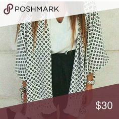 SALE ❗❗ Boho Kimono Jacket Lightweight black and white chiffon kimono jacket with boho tasseled hem.   One size fits most- recommend up to XL.   Bust 40 inches & Length 30 inches  So chic and versatile for everyday wear with jeans or a chic maxi skirt.    Limited availability. WILA Jackets & Coats Blazers