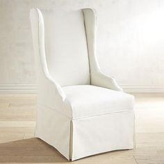 Seating - Crafted with a birch frame, foam padding and dressed in a removable, cotton slipcover, our Aislin Dining Chair has a high back, curvy arms and a tailored skirt giving it a pretty demeanor with a no-nonsense attitude.