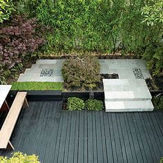 26 great ideas for decks | Small is beautiful | Sunset.com  bamboo privacy screen | Two varieties of bamboo (green canes and black) act as a privacy screen along the back fence, while Pittosporum undulatum and a bronze-leafed Japanese maple shade the corners.