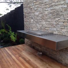 Canterbury project BBQ looks great floating off the new stonework. Outdoor Barbeque, Barbecue Area, Outdoor Fire, Outdoor Living, Barbacoa Jardin, Stone Bbq, Bbq Places, Bbq Bar, Bbq Island