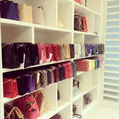 Purse closet! Love the pink with rose Louis Vuitton purse.