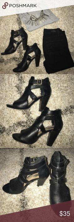 Steve Madden black leather cutout bootie heels. Black leather cutout strappy bootie heels.  3 1/2 inch heel height.  Zipper at heel for easy on and off.   Gently worn with some scuffing at heels and on the toes as pictured.  Brass buckle on sides. Steve Madden Shoes Heels