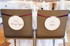Funny signs for the back of the bride and groom chairs {Photo by Jonathan Young Weddings via Project Wedding}