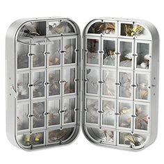 """Orvis Wheatley Signature Box  https://fishingrodsreelsandgear.com/product/orvis-wheatley-signature-box/  The classics never fade. Gift this iconic fly box to your fishing friend, but be certain to keep one for yourself. You'll be wanting it. A total of 32 compartments in the lid and base ensure a home for all your favorite dries. In silver. 6″ x 3 1/2 """" x 1⅝"""". Flies not i..."""