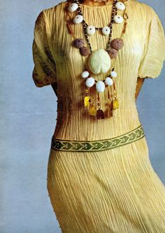 Gloria Vanderbilt as a model wearin a  Fortuny Delphos dress in stunning jewels of Rita Delisi. Photo of Richard Avedon for Vogue Italy, 1970.