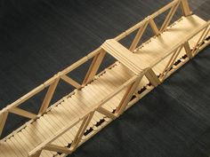 Popsicle Stick Bridge by Ian Thacker with Ins - Fairy Lights Terrace Popsicle Bridge, Popsicle Stick Bridges, Popsicle Stick Houses, Popsicle Stick Crafts, Craft Stick Crafts, Craft Sticks, Village Miniature, Miniature Houses, Small World Play