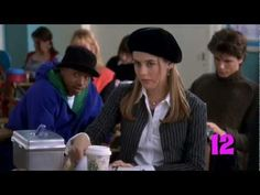 """Every Outfit Cher Horowitz Wears in Clueless. I especially love that """"I'm in love with Josh"""" sheer blouse/ argyle skirt combo, the Calvin Klein dress and over-the-knee socks."""