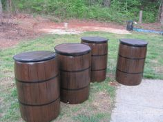 I needed whiskey barrels for my daughters wedding reception. Looked all over for them they were too expensive so I painted white plastic barrels and added a wooden top cut out of plywood.