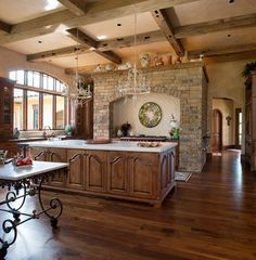 Reclaimed ceiling beams and wide plank reclaimed wood flooring are a great combination in this traditional kitchen. Faux Wooden Beams, Reclaimed Wood Floors, Wood Beams, Modern Farmhouse Interiors, Rustic Interiors, Farmhouse Style, Wide Plank Flooring, Wood Flooring, Walnut Timber
