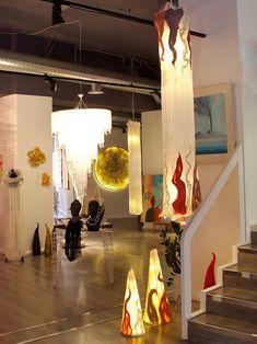 Veasta Wall Lamp in felt. Design Judith Byberg. Silk Chiffon, carded Bergschaf wool, and hemp fibers natural white. Extrafine Merino wool tops natural colors. Structure: metal chimney brush. 40 x 210 cm. Led light.