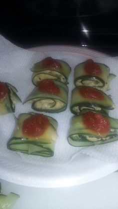 Cucumber roll ups I made. Homemade hummus and quinoa in the middle. Tomato sauce on top. So delicious and filling.