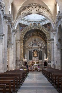 Main Altar - Santa Maria del Popolo _ Rome, Italy -  The church houses the works of many famous artists: Raphael, Gian Lorenzo Bernini, Caravaggio, Pinturicchio, Andrea Bregno, Guillaume de Marcillat and Donato Bramante.