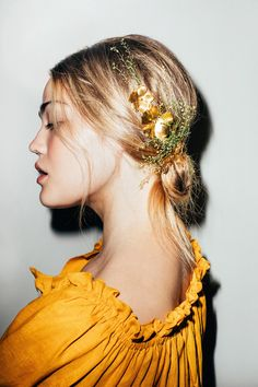The fastest way to dress up your favorite simple, breezy summer dress is with a few twists of hair and one of these dreamy hair accessories. Here's how.
