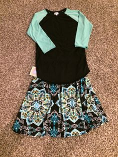 Here is the super popular LuLaRoe Randy baseball T-shirt paired with the Azure skirt. What I love about the Azure is that you can wear it as a skirt or a shirt! Come shop with LuLaRoe Katie and Kelly by clicking the picture. Interesting in becoming a consultant, ask us how!