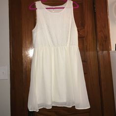 Very flirty ivory colored flare dress Size XL flare cream/ivory colored dress. Fits up to 1x. Approx 37 inches from shoulder to hem. Lined. 100% Polyester. Worn once lightly. Dresses