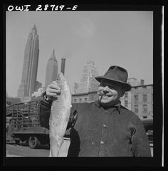 Fisherman holding a large catch at the Fulton Fish Market in New York. Photo by Gordon Parks, 1943.  Farm Security Administration - Office of War Information Photograph Collection, Library of Congress Prints and Photographs Division.