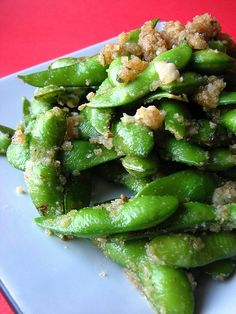 Garlic Parmesan Edamame:   1 (16 oz) pkg frozen edamame in shell 1/2 c extra-virgin olive oil 4 cloves garlic, minced 1/2 c Italian-seasoned bread crumbs 1/2 c freshly grated Parmesan cheese salt to taste