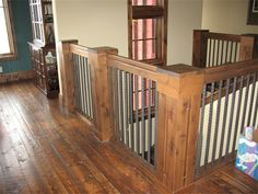 Rustic Decor: paneled colums and wrought iron spindles
