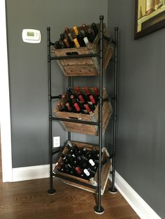 Wine rack from pipes and old milk crates