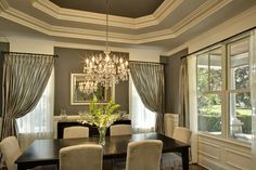 A similar paint trio to try is Anonymous 7046 for the walls, Amazing Gray 7044 for the outer portion of the ceiling, and Porpoise 7047 for the darker part of the ceiling. All of the colors are by Sherwin-Williams