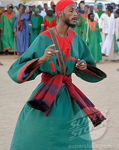 Here we see the Sufi dancign by Dervishes in Sudan influenced by the Turkish Sufi Islamic religion, but they have incorporated their own folk wear and colours,