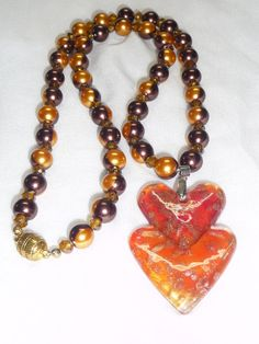 Valentine's Love Hearts Lampwork Necklace with Chocolate Orange Glass Pearls and Crystal Bling Handmade Unique. $25.00, via Etsy.